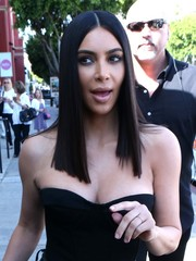 Kim Kardashian rocked a perfectly sleek, center-parted hairstyle while out and about in Beverly Hills.