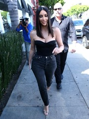 Kim Kardashian was a head turner on the streets of Beverly Hills in a strapless black corset top that played up her curves.