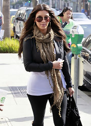 Kim Kardashian looked stylish wearing a nubby fringed beige scarf while out in Beverly Hills.