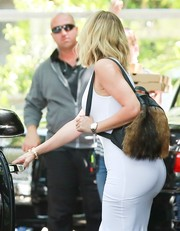 Khloe Kardashian stepped out for lunch rocking a furry backpack.