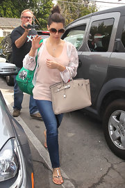 Kim Kardashian headed to a spa wearing a pair of silver strappy sandals.