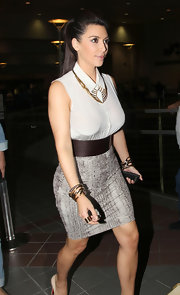 Kim Kardashian paired her sexy skirt with a sleeveless white button-down by Givenchy.