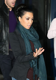 Kim was spotted doing what she does best, shopping. Her classic bun was full of volume and shine!