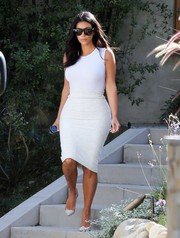 Kim Kardashian kept the girls under wraps in a simple white tank top while visiting a friend.