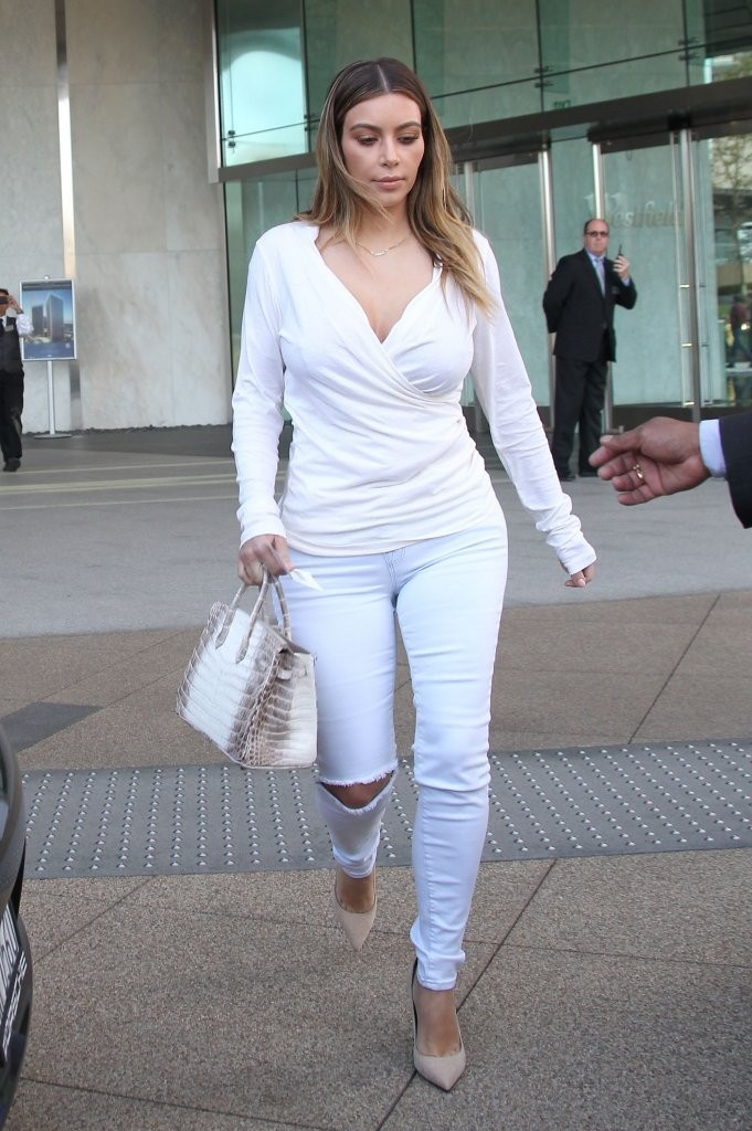 c7f2217d380a Reality star and new mom Kim Kardashian wears all white while stopping by  an office in
