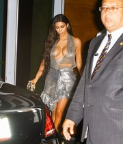 Kim Kardashian matched her racy top with an asymmetrical silver mini skirt by Paco Rabanne.