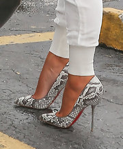 Kim Kardashian looked high-fashion from the ground up in these super-tall python platforms.