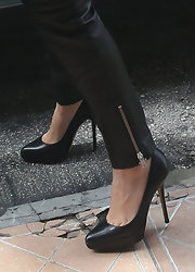 Kourtney gave her leather look some lift with a sleek pair of pumps.