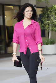 Kim Lee brightened her black leggings with a sheer fuchsia button up that revealed a cheeky leopard print bra.