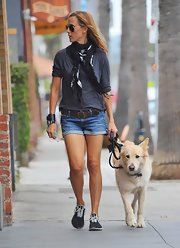 Kim Raver sported a pair of short cuffed denim shorts while walking her dog.