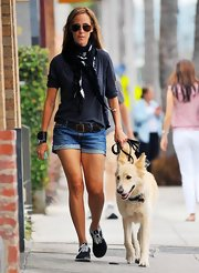 Kim Raver wore a brown woven leather belt with her denim shorts while walking her dog.