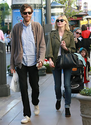 Kirsten Dunst's cuffed jeans revealed black suede ankle boots with wooden platforms.