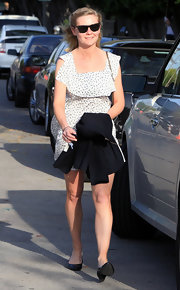 Kirsten Dunst trekked through West Hollywood in a pair of black patent leather pumps with low sturdy heels.