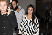 Reality star Kourtney Kardashian arrives on a flight from New York at LAX airport in Los Angeles.
