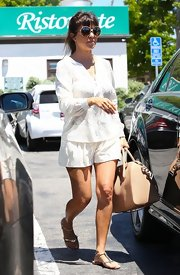 Kourtney's white shorts matched her flowing top and gave her an easy breezy look.