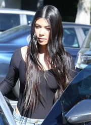 Kourtney Kardashian stepped out in LA wearing super-long wavy tresses.