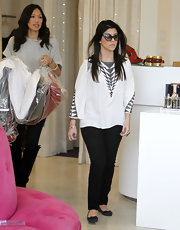 Kourtney oozed casual chic style in black skinny jeans paired with classic ballet flats.