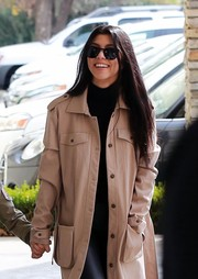 Kourtney Kardashian enjoyed a movie date wearing a cool beige trenchcoat.