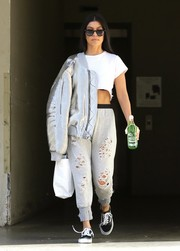 Kourtney Kardashian nailed space-age chic with this silver bomber jacket by Off-White!
