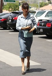 Kourtney Kardashian rocked denim on denim when she paired this light-wash button down with a darker pencil skirt.