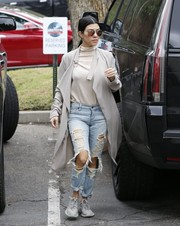 Kourtney Kardashian rocked ripped denim jeans while spotted out and about.