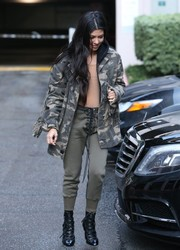Kourtney Kardashian teamed her jacket with tan lace-up sweatpants by Unravel.