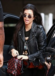 Kourtney Kardashian put on a pair of oval shades for a sunny day out in LA.