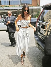 Kendall Jenner looked effortlessly chic in a black-and-white striped tube top by Keepsake while filming her reality show.