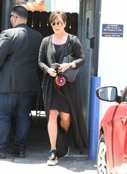 Kris Jenner was spotted outside a Van Nuys studio wearing a black duster coat over an LBD.