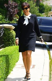 Kris Jenner sported this long-sleeve black dress with white trim and bow embellishments.