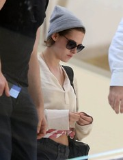 Kristen Stewart topped off her airport outfit with a gray beanie by Huf.