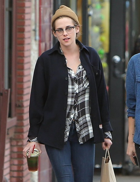 Kristen Stewart wore a tan knit beanie with a jacket and a plaid blouse for a lunch out.