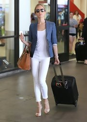 Kristin Cavallari chose a denim blazer to add some spice to her all-white travel look.