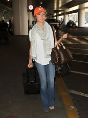 Kristin was spotted arriving at LAX toting a classic Speedy bag.