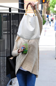 Kristin carried a classic white tote while out shopping.