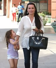 Kyle Richards' daytime look was super relaxed with this loose white blouse.