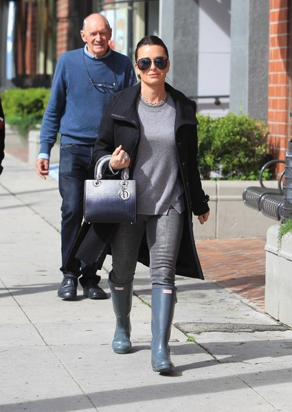 Kyle Richards added a touch of glamour with a metallic ombre tote by Dior.