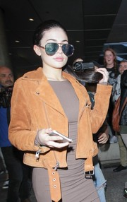 Kylie Jenner rocked oversized aviators by Quay as she arrived at LAX.