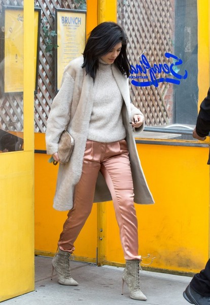 Kylie Jenner Suede Clutch [yellow,photograph,street fashion,clothing,snapshot,orange,jeans,fashion,footwear,outerwear,jeans,family,members,kylie jenner,kardashian,clothing,fashion,restaurant,new york new york,city,jeans,trousers,fashion,celebrity,coat,leggings,clothing,socialite,shorts,shoe]