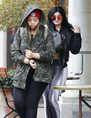 Kylie Jenner looked cool wearing these orange aviators by Quay while out and about in Calabasas.