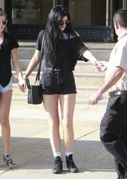 Kylie Jenner was spotted out in New York City wearing a black boatneck tee.