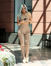 Kylie Jenner looked fierce in her matchy-matchy Tamara Mellon suede pants and top.