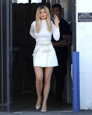 A multi-buckled white mini skirt by Derek Lam 10 Crosby provided an edgy-sexy finish to Kylie Jenner's look.