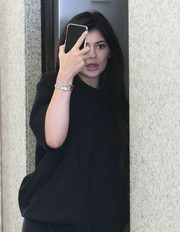 Kylie Jenner teamed a silver bangle with a plain black tee for a visit to a medical building in Beverly Hills.