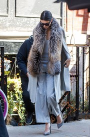 Kendall Jenner went matchy-matchy, pairing her cape with gray wool wide-leg pants, also by Sally Lapointe.