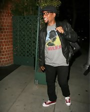 D.L. Hughley chose a casual screen print tee featuring Miles Davis for his evening look while grabbing a bite to eat.