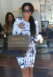 La La Anthony went shopping in Hollywood looking super chic in cateye sunnies and a curve-hugging print dress.