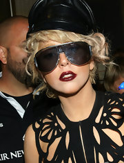 Lady Gaga completed her cut-out ensemble with Gothic-inspired dark lipstick. What a perfect finish to her look!