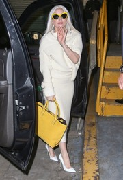 Lady Gaga punctuated her neutrals with a yellow leather tote.