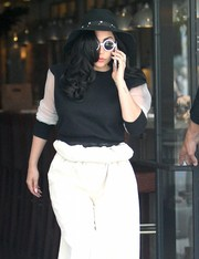 Lady Gaga was almost unrecognizable with her round shades and her jet-black curls covering half her face as she shopped on Melrose.